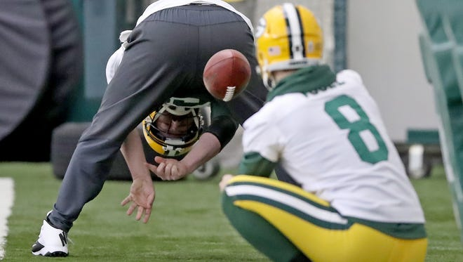 Green Bay Packers long snapper Brett Goode (61) works on his snaps with punter Justin Vogel (8) during practice a November 2017 practice.