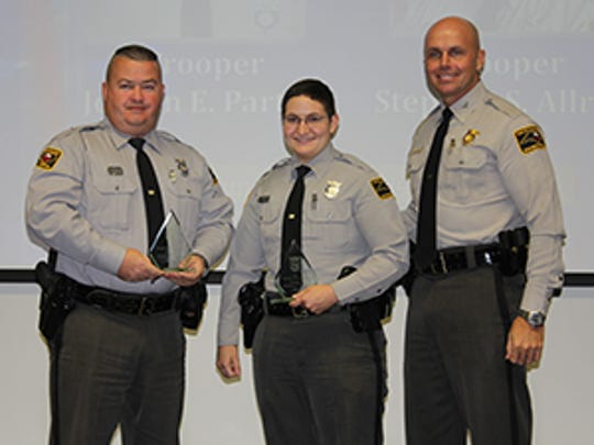 Troopers Stephen Allred and Jordan Parton receive their award Tuesday in Raleigh.