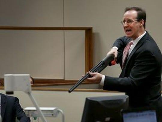 Prosecutor William Gargan shows the jury in the Charles