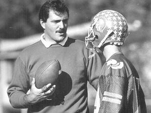 North College Hill football coach Bruce Baarendse talks with wide receiver Rick Kates in 1987. Baarendse passed away after a battle with cancer on Dec. 3, 2015.