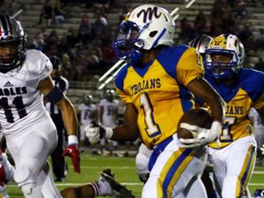 Moody's Dajon Moore ran for 168 yards, and two fourth-quarter touchdowns, to help the Trojans rally for a 35-28 overtime win over Veterans Memorial.