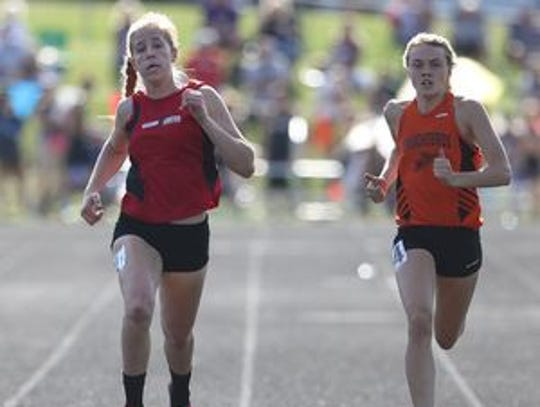 Fischer (right) will compete in the 300 hurdles, long