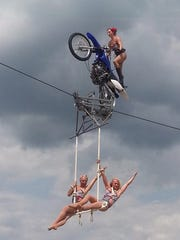 The riders are high during the Circus Una act. They will perform at Delmarva Bike Week in September 2016.
