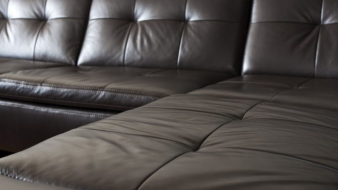Unless you're staying for a long time, it's best to avoid a sectional photo. Should you ever move (very likely!), the configuration and/or size of the sofa may not work in your future abode.