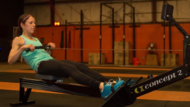 Lauryn Lax uses a rowing machine in Austin, Texas, where she is working as an occupational therapist to meet her clinical requirements. Lax has struggled with anorexia since she was 10 years old. She eats better now after spending 11 months in a residential treatment program for anorexia nervosa.