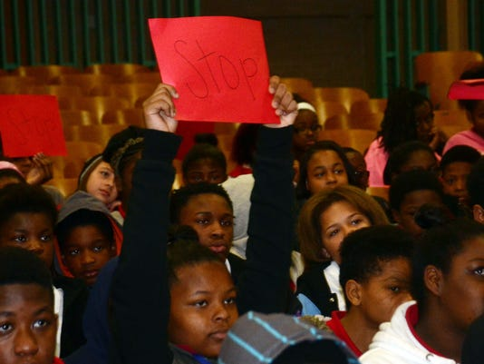 "ANI AMMS Anti-Bully Rally Alexandria Middle Magnet School held an anti-bullying rally Thursday, Feb. 26, 2015. Students were given signs with the word ""Stop"" on them and while watching a bullying demonstration told to hold up the signs to stop the bullying"