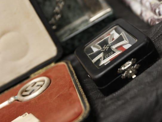 Detail of artifacts bearing Nazi symbols that were