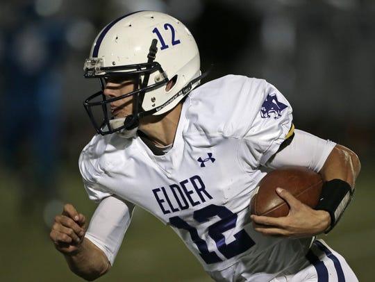 photos by The Enquirer/Sam Greene Elder quarterback
