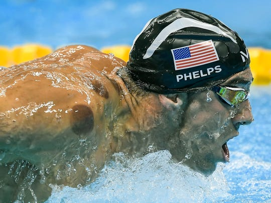 United States swimmer Michael Phelps advanced to the finals of the men's 200-meter butterfly semifinal Monday, August 8, 2016, at the Olympic Aquatics Stadium at the 2016 Summer Olympics Games in Rio de Janeiro, Brazil. Circles on Phelps' body are the result of his use of cupping therapy.