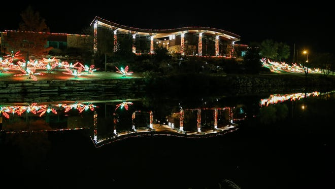 Poinsettia shaped lights decorate the area around the San Angelo Convention and Visitors Bureau for the Tour of Lights.