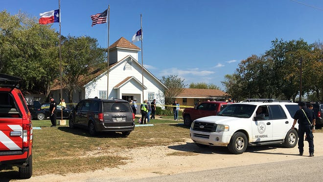 Emergency personnel respond to a fatal shooting at a Baptist church in Sutherland Springs, Texas, on Nov. 5, 2017.