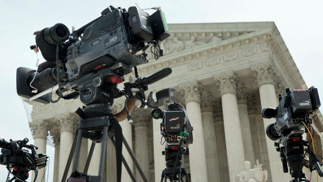 News cameras are set up outside the Supreme Court Building in Washington D.C. ahead of a confirmation hearing. Cameras of any kind are prohibited inside the court, a move critics say prevents transparency and honesty.