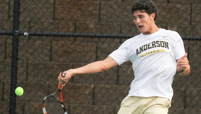 Ignacio Bidegain returns a ball during practice at the Anderson University Sports Complex tennis courts.