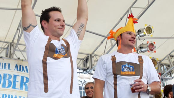 """Drew (left) and  Nick Lachey leading the """"Chicken Dance"""""""