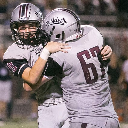 Dylan Brown (left) and Chris Collins celebrate Brown's game-winning field goal for Chandler Hamilton against Phoenix Pinnacle on Friday in one of the most thrilling games Richard Obert has covered in his reporting career.