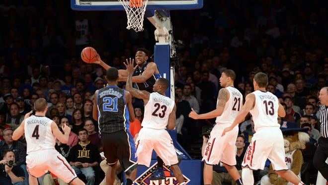 Duke's Jabari Parker looks to make a pass in crowd on Friday night at Madison Square Garden.