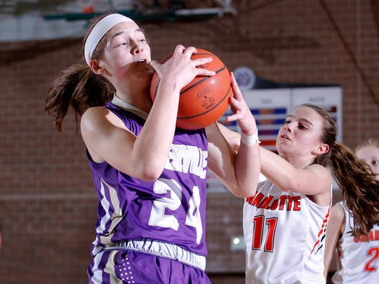 Fowlerville's Elie Smith, left, grabs a rebound against Charlotte's Carly Scheblo (11) in their Class B MHSAA regional game, Tuesday, March 6, 2018, in Williamston, Mich. Fowlerville won 52-40.