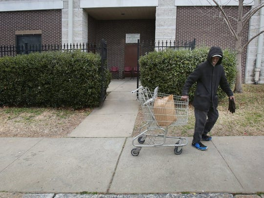 February 10, 2016 - A client of St. Patrick Catholic Church food pantry leaves with his three-day supply of food. The Shelby County Health Department has completed a study that compares poverty, health, environmental and other factors throughout the county by ZIP code. The epidemiologists who did the work say their report confirms what they'd already know. (Stan Carroll/The Commercial Appeal)