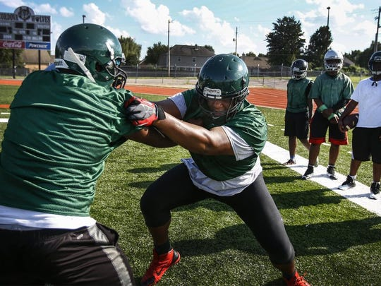Cordova defensive lineman Quinton Bohanna (middle) works on rushing a blocker during a preseason practice. (Mark Weber/The Commercial Appeal)