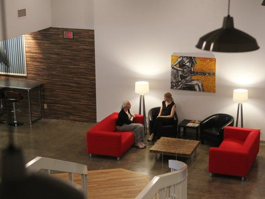 File photo - Hope Seth, right, director of Entrepreneurial Development with the Economic Development Corp., talks with Yvonne Mazzotta in August 2015 at the EDC's business incubator Shasta Venture Hub in Redding. Andreas Fuhrmann/Record Searchlight