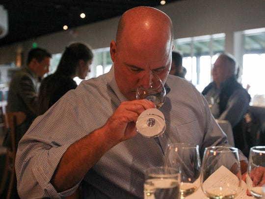 Regan Jasper, with Fox Restaurant Concepts, sniffs a wine before tasting it at The Arizona Republic Wine Competition at Tarbell's in Phoenix,  Arizona on October 26, 2015. (Photo by Ben Margiott/The Republic)