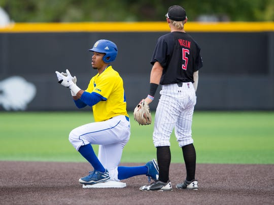 Delaware's Jordan Glover celebrates after stealing second base in the first inning Friday at Texas Tech.