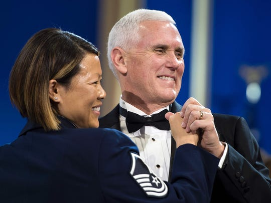 Vice President Mike Pence dances with Air Force Master Sgt. Tiffany Bradbury during an inaugural ball honoring members of the Armed Services, January 20, 2017 in Washington, DC.