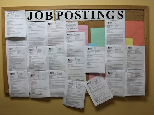 A jobs posting board hangs on a wall.