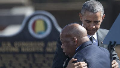 In this March 7, 2015, file photo, President Barack Obama hugs John Lewis before speaking on the 50th anniversary of Bloody Sunday at the foot of the Edmund Pettus Bridge in Selma. The U.S. Navy last week announced it would name one of its ships after Lewis, a longtime congressman and civil rights icon.