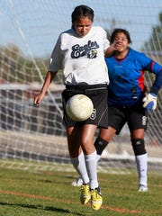 Navajo Prep's Nichelle Silversmith protects the goal against Academy for Technology and the Classics on Tuesday at Eagle Stadium.