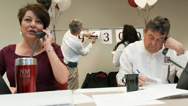 New Mexico State University Vice President of Student Affairs and Enrollment Mangement Bernadette Montoya, left, and NMSU Foundation Board member Pat Lamb call and thank donors during the GivingTuesday event at the Corbett Center Student Union.