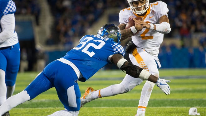 Tennessee quarterback Jarrett Guarantano (2) looks for room to run during a game at Kentucky on Saturday.
