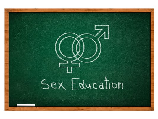 Sex symbols and sex education in chalk on green chalkboard