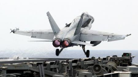 The Navy is placing a retired F/A-18 Hornet at the main gate of Naval Air Station Pensacola