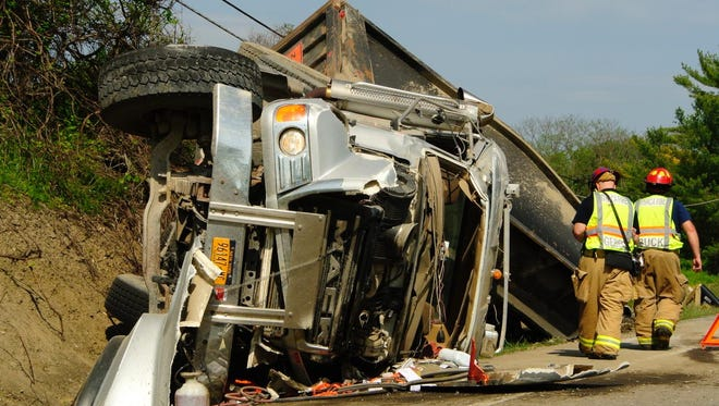 A truck carrying a load of blacktop overturned on state Route 96 near Cayuga Medical Center Friday morning.