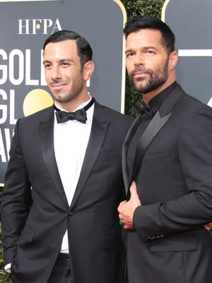 Ricky Martin, right, and Jwan Yosef, arrive at the Golden Globes on Jan. 7, 2018.