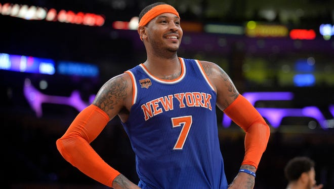 New York Knicks forward Carmelo Anthony reacts during the 118-112 victory against the Los Angeles Lakers at Staples Center.