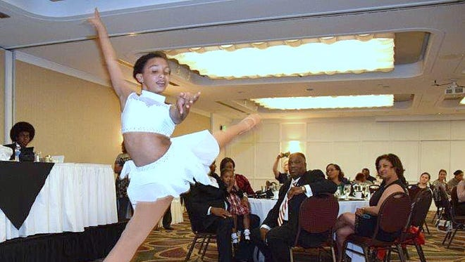 Dancer Emersyn Garvin performs during the annual NAACP Freedom Fund Awards dinner at the Corning Radisson Hotel.