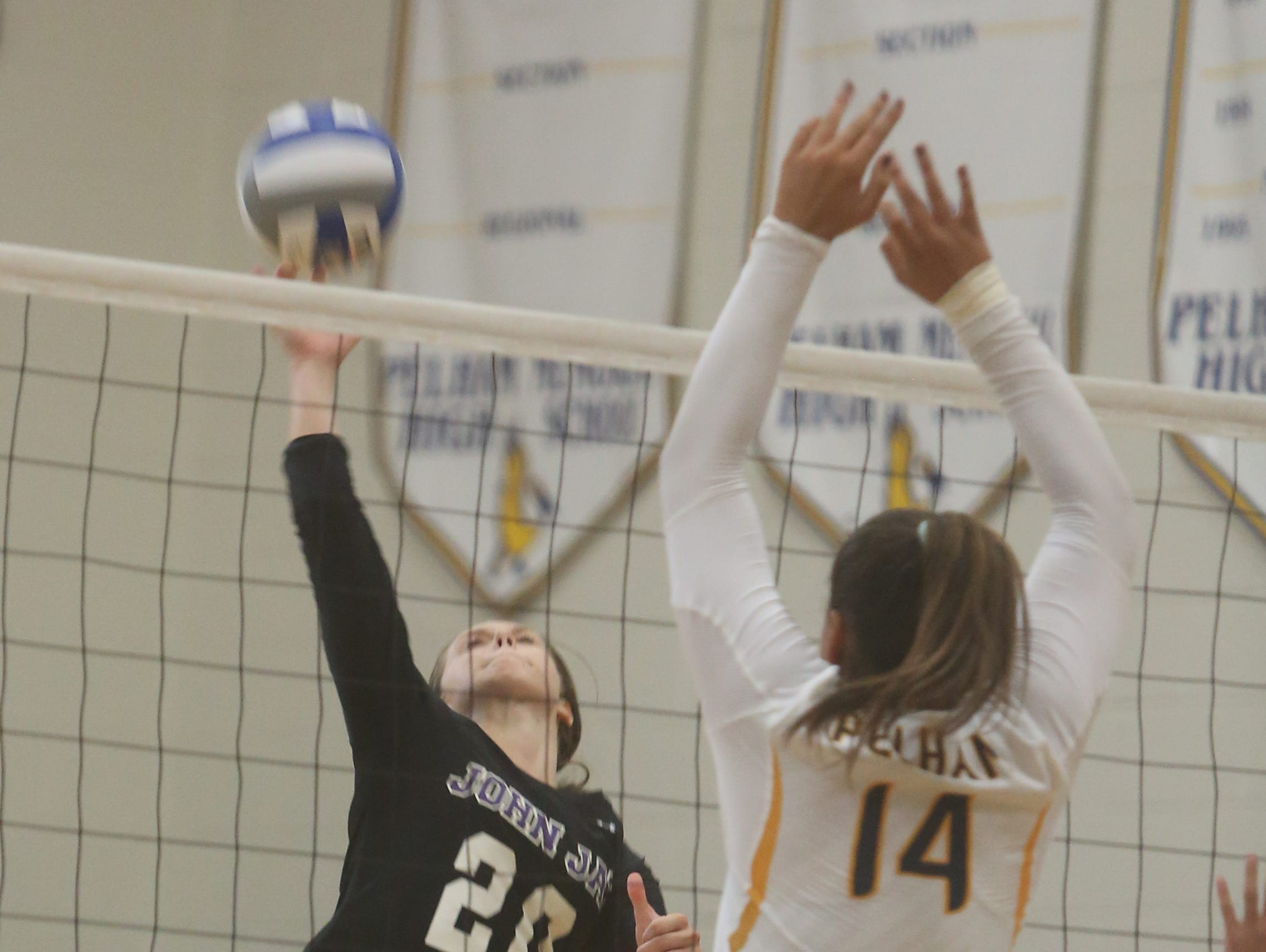 John Jay and Pelham battled in a varsity volleyball match at Pelham High School Sept. 3, 2015.