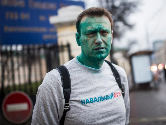 Russian opposition leader Alexei Navalny poses says