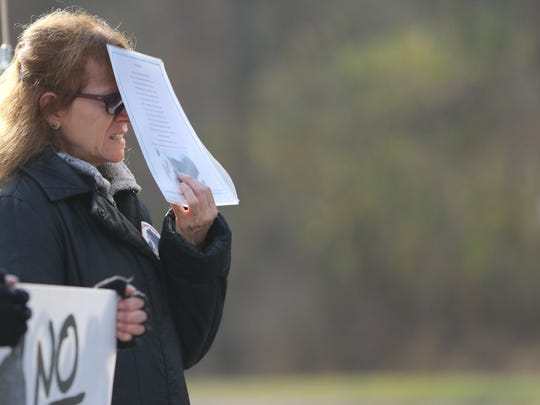 Doreen Frega of Saddle Brook, who was in Fredon protesting the black bear hunt, looks distraught after seeing a fourth dead bear being brought into the Whittingham Wildlife Management Area on Monday.