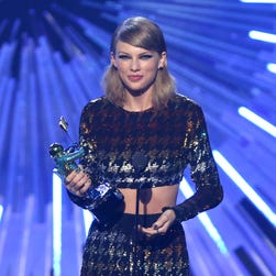 Taylor Swift accepts the award for female video of the year for 'Blank Space' at the MTV Video Music Awards. She also won Video of the Year for 'Bad Blood.'