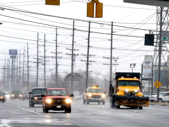Traffic continues as normal along South Church street in Murfreesboro despite a wintery mix of rain, sleet and freezing rain moving through the area on Friday, Jan. 12, 2018.