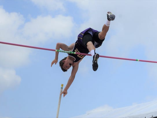 Wylie's Kylor Aguilar starts to let go of his pole after clearing the bar during the Class 4A boys pole vault at the UIL State Track and Field Championships at the University of Texas' Mike A. Myers Stadium in Austin on Saturday. Aguilar won a silver medal with a jump of 15 feet.