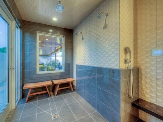 The master bathroom includes an expansive walk-in shower