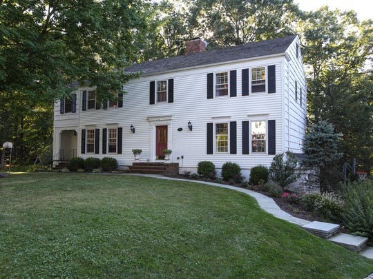 This Chatham Colonial has two fireplaces; a kitchen with granite counters; a walk-out lowerlevel with media room and a two-car garage. It's offered at $850,000. Call Debbie Woerner at 973-635-8200 (office) of 973-495-2864 (cell).