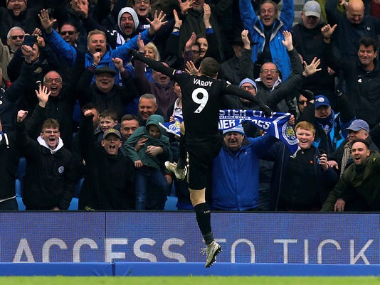 Leicester City's Jamie Vardy celebrates scoring his side's second goal of the game during their English Premier League soccer match against Brighton and Hove Albion at the AMEX Stadium, Brighton, England, Saturday, March 31, 2018. (Gareth Fuller/PA via AP)