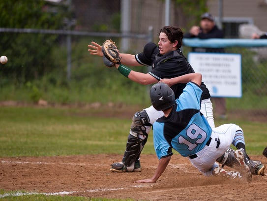 South Burlington runner Gabe Frigo (19) slides into