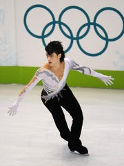 Johnny Weir of the U.S. performs in the men's 2010
