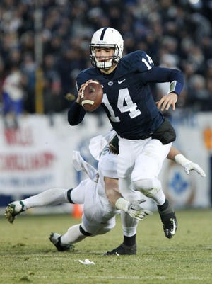 Nov 29, 2014; University Park, PA, USA; Penn State Nittany Lions quarterback Christian Hackenberg (14) scrambles with the ball during the second quarter against the Michigan State Spartans at Beaver Stadium. Mandatory Credit: Matthew O'Haren-USA TODAY Sports